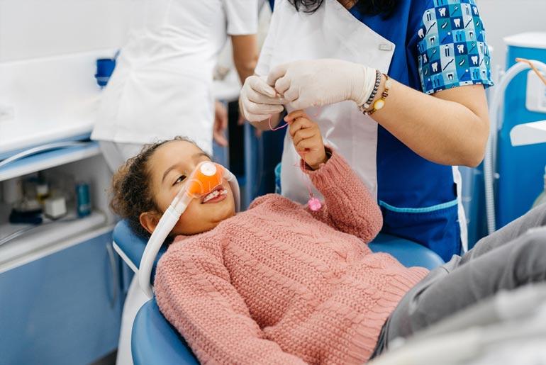 girl in dentist chair for sedation dentistry